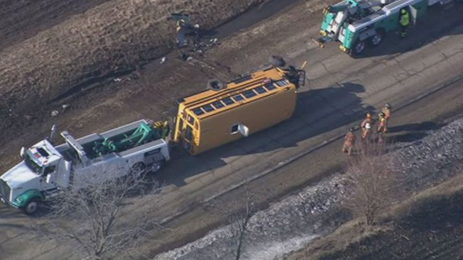3 Injured When School Bus Rolls Onto Side