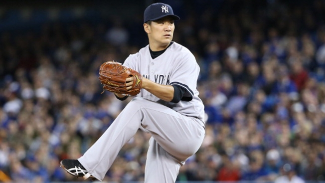Tanaka Wins Debut, Yankees Beat Blue Jays 7-3