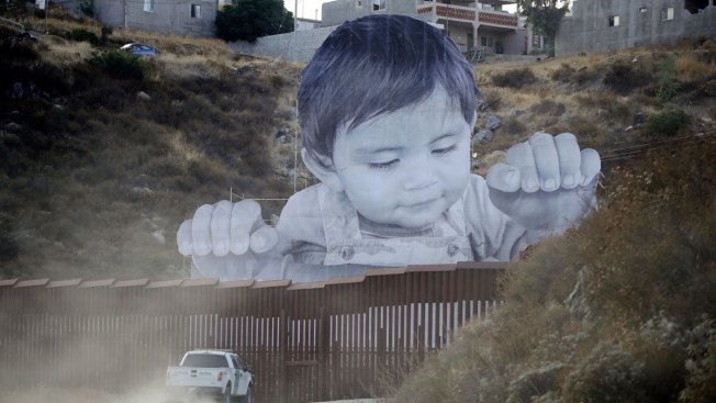 Giant Portrait of Toddler Peers Over US-Mexico Border Wall