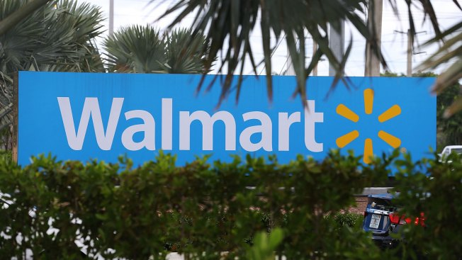 Wal-Mart plans to cut hundreds of jobs this month