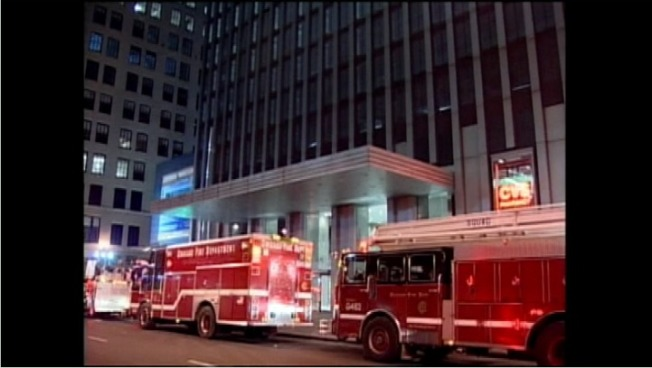 Man, Rescuer Trapped in High-Rise Elevator