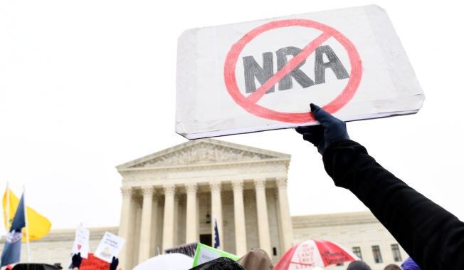 Roberts Seems to Hold Key to Case Over New York City Gun Law