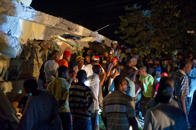 Quake Scene: Fears for Two Trapped Americans