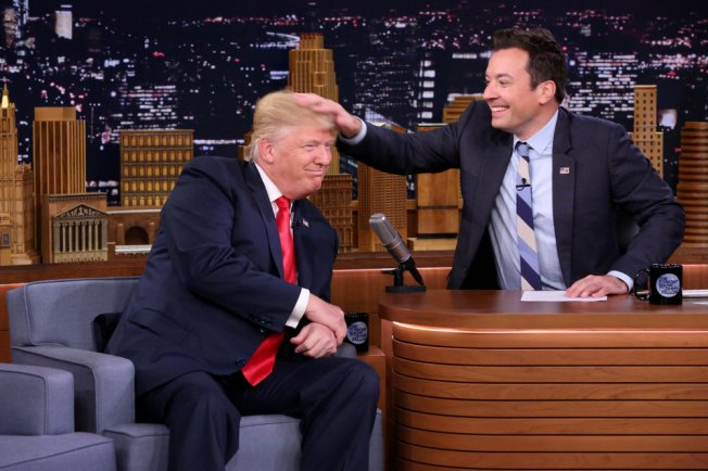 Fallon gives in to temptation, musses Trump's 'do