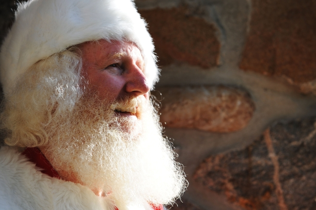 Woe, Woe, Woe:  Santas Hear Kids' Take on Bad Econonmy