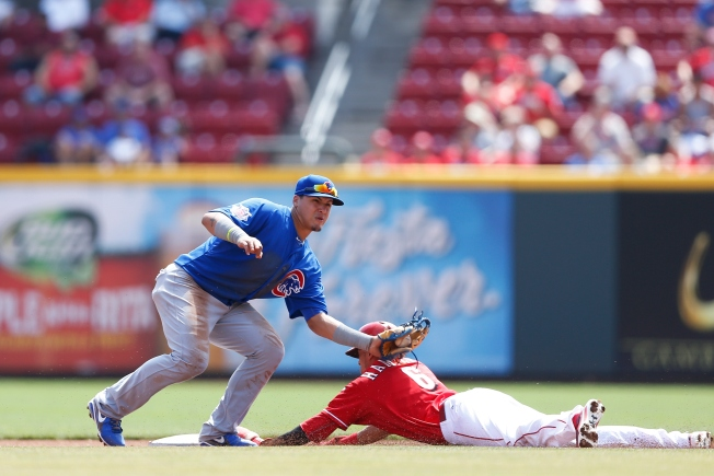 Reds Steal 7-2 Win Over Cubs
