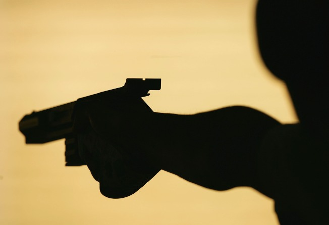 Man Held After Shooting Death