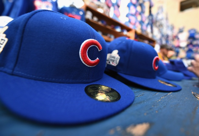 d64489a3043 FBI Warns Chicago Cubs Fans of Fake Memorabilia. Chicago Cubs hats for sale  sit on display outside ...