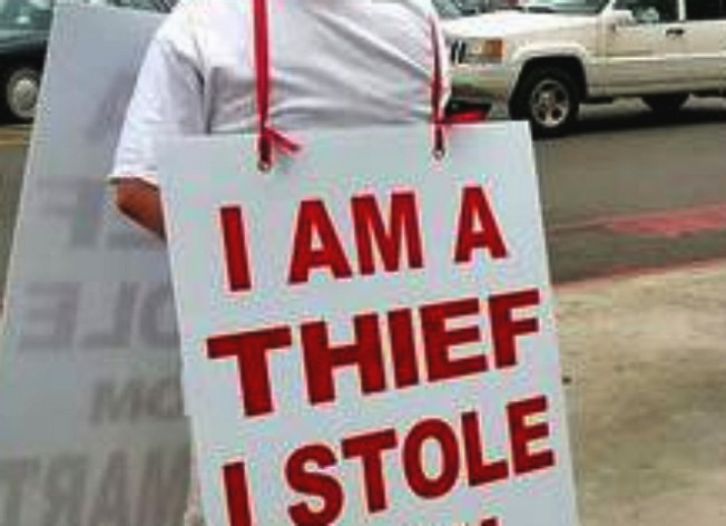 "No Lessons Learned from Holding ""I am a Thief"" Sign"