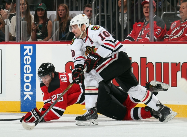 Sharp, Keith Make Huge Contributions as Hawks Beat Devils