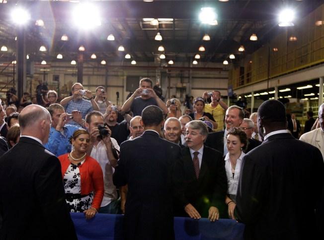 Obama touts stimulus in hard hit town