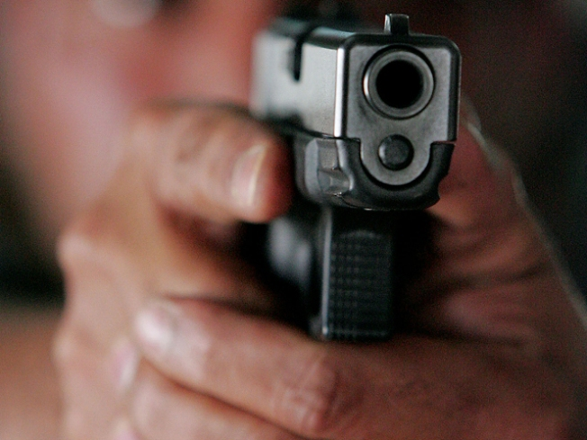 Robbery Victim Grabs Gun, Escapes Car, Shoots Assailant