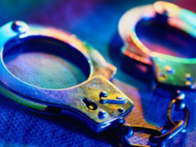 Alleged Gang Member Flees, Gets Stuck in Mud