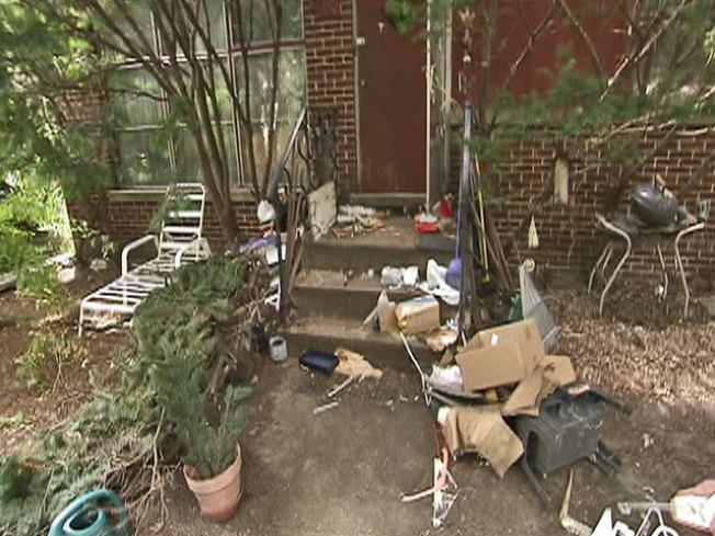 Woman Found Dead in Garbage-Filled Home
