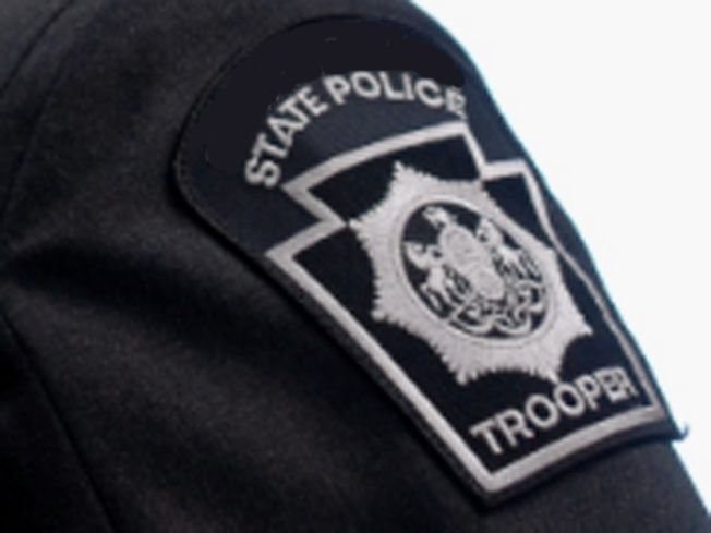 State Trooper's Squad Slides Under Tractor Trailer