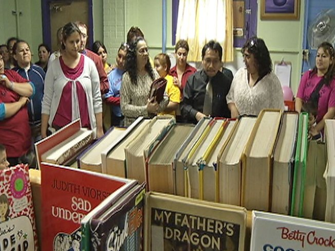 Parents Build Library in Building Slated for Demo