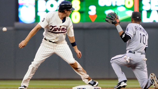 Peavy, Rios Lift Sox Over Twins