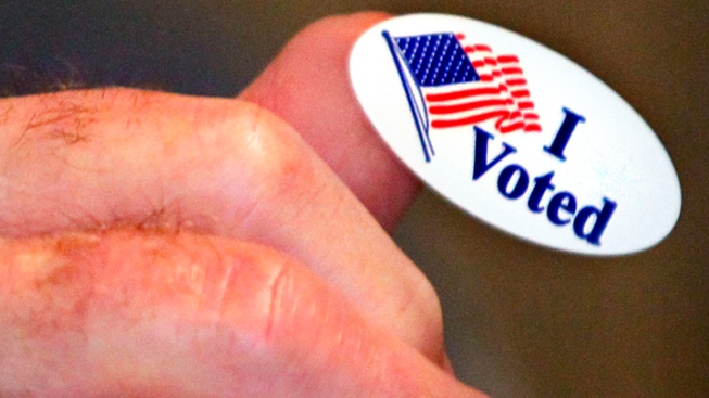 Husband Jumps in Front of Wife's SUV to Keep Her from Voting, Police Say