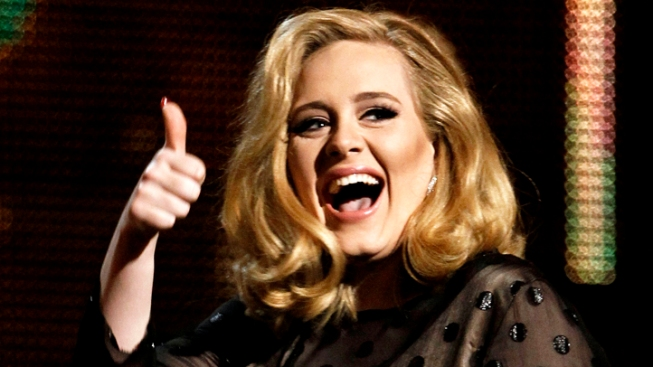 Adele Flips the Bird at Brit Music Awards Host During Acceptance Speech