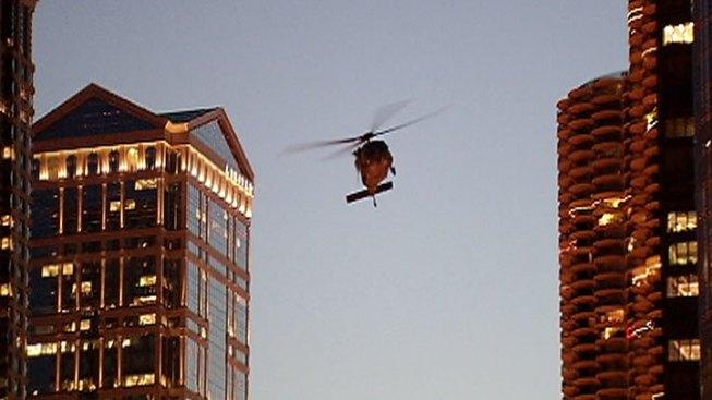 Blackhawk Choppers Buzz Chicago Skyscrapers