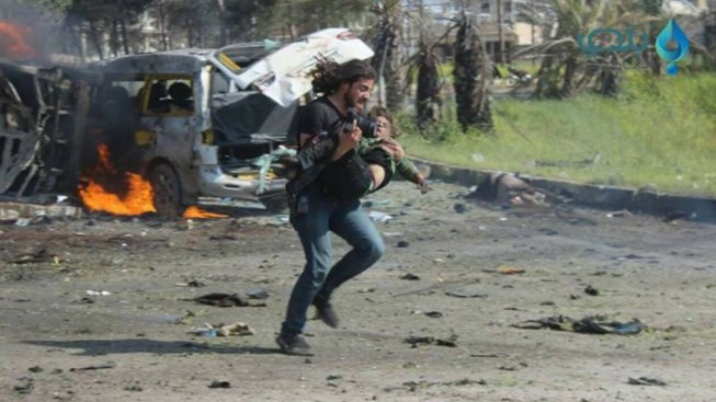Syrian Photographer Drops Camera to Rescue Child
