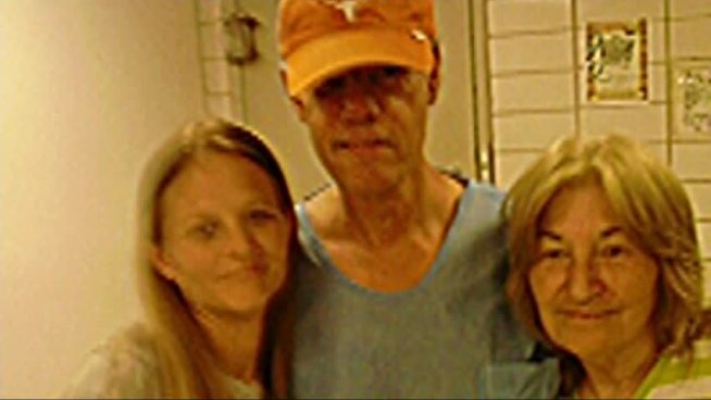 While spending the night behind bars, country superstar Randy Travis found time to take pictures with fans at the Grayson County Jail.