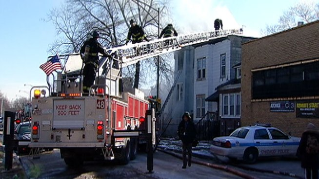 Woman Critical After Jumping From Burning  Building