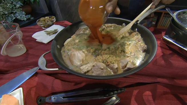 Wayne makes one of Zoraida's favorite dishes: arroz con pollo