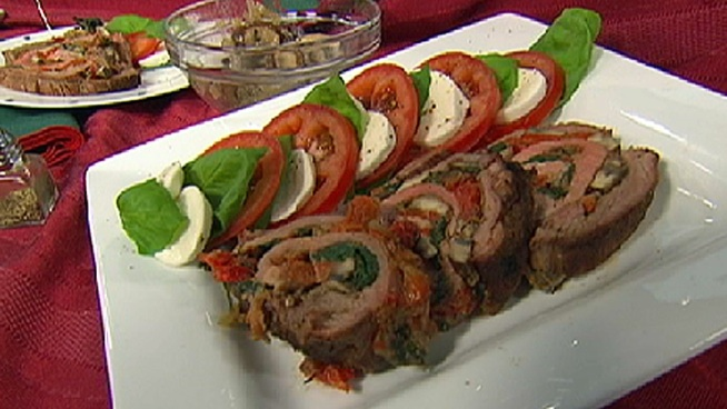 Wayne shows off a grilled flank steak stuffed with roasted red pepper ...