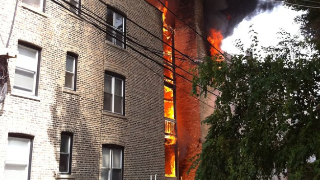 Three-story apartment building near Cornelia and Halsted went up in flames at about 2 p.m. Saturday.