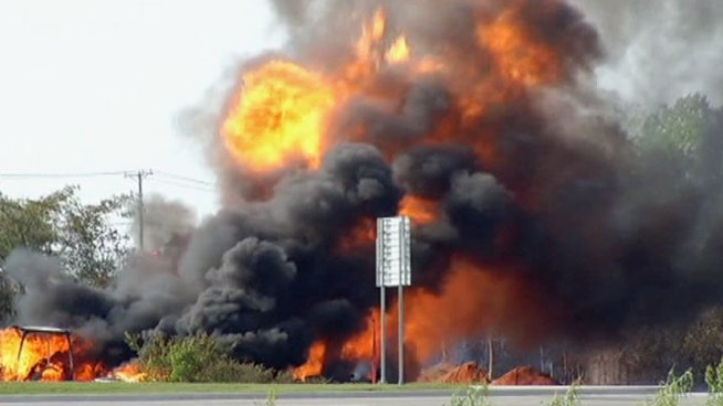 Utility officials say four people hurt in a natural gas pipeline explosion north of Dallas all have minor injuries. A crew was working in McKinney when a piece of equipment ruptured the line, sending up flames and thick black smoke.