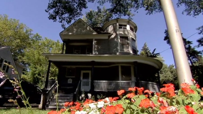 The gray, two-story Victorian on Elm Street in Glen Ellyn has been moved and completely restored.