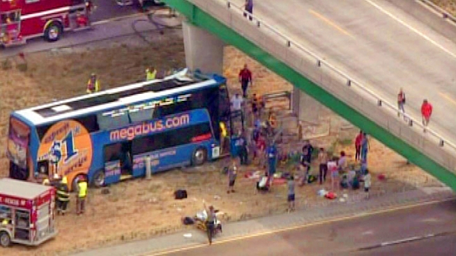 A double-decker Megabus was badly damaged after striking a pillar along Interstate 55 in southern Illinois. This video from a chopper above the scene shows first responders tending to the scene.