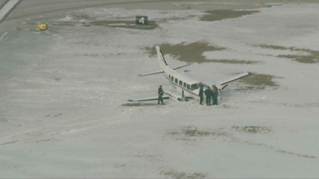 Plane Slides Off Midway Runway