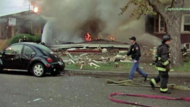 A massive explosion levels a house in the West Lawn neighborhood Sunday morning.