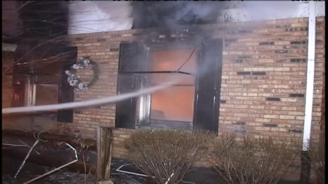 An explosion was reported early Tuesday in south suburban Morris. When fire crews arrived to reports of a garage fire, the structure was completely burned and the door had blasted into the driveway.