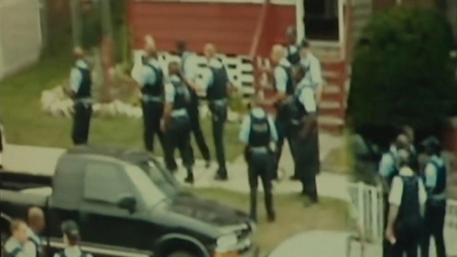 In a federal lawsuit, LaMonte Simmons says dozens of officers witnessed another officer attack him but failed to intervene. A neighbor captured video of the incident.