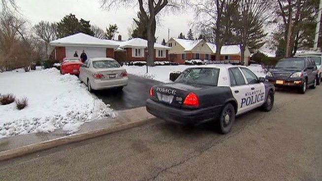An 82-year-old north suburban woman was tied up in her home while being robbed at Thursday night, and police are looking for three people who forced there way in wearing masks.
