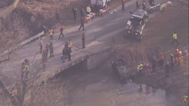 Crews pull a car from Forked Creek in Will County after it plunged into the water overnight. Four teens reportedly were killed in the crash.