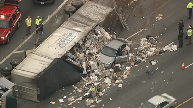 Overturned Truck Spills Trash Onto Md. Freeway