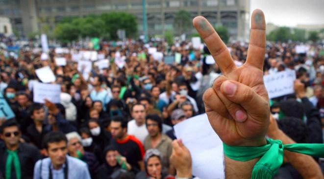 Defiant Iranians Clash With Riot Cops