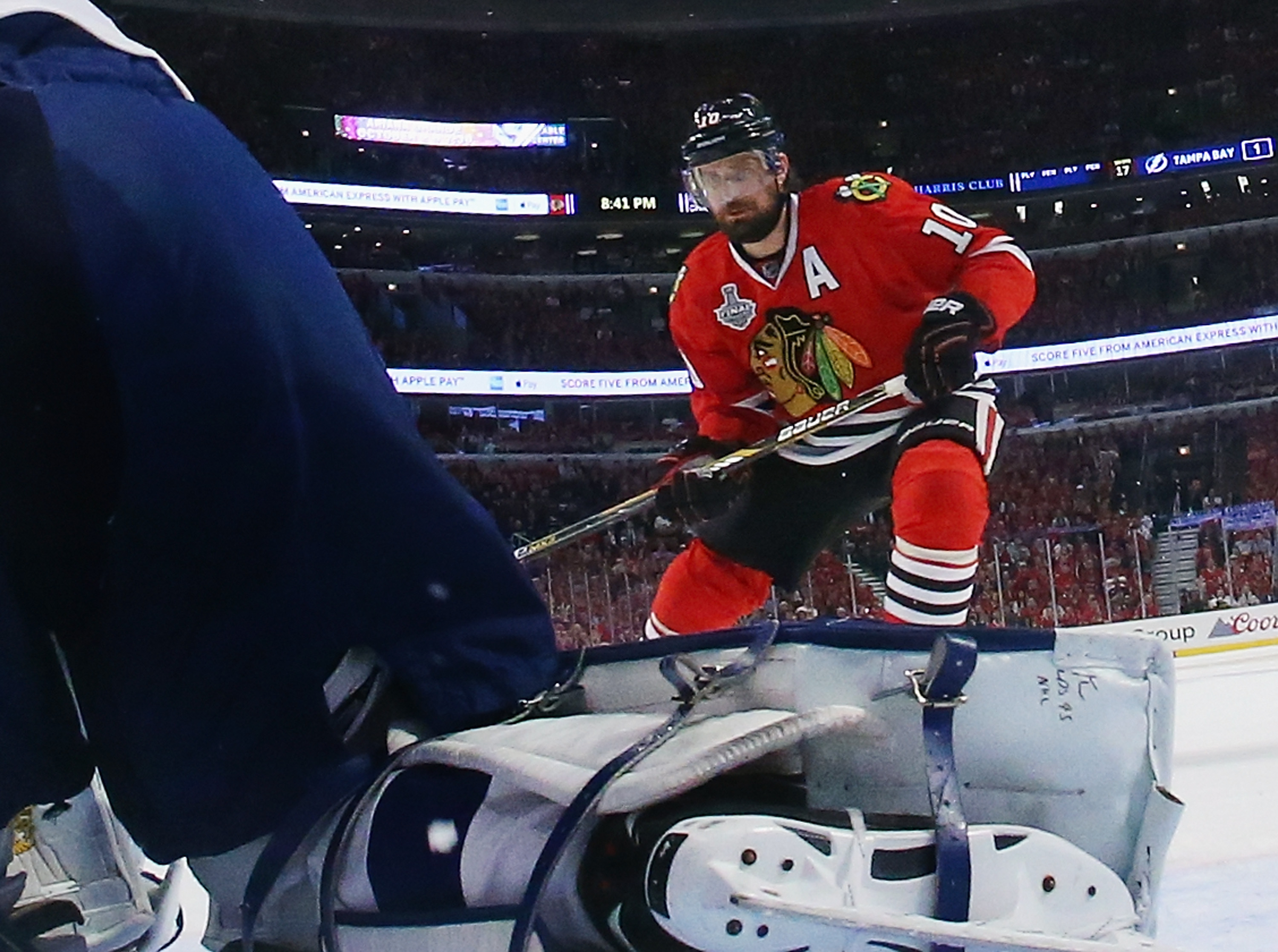 Patrick Sharp 10 of the Chicago Blackhawks skates against the Tampa Bay Lightning during Game